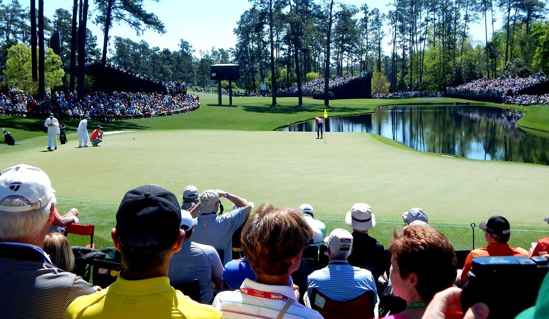 Fans watch practice rounds for the Masters in Augusta