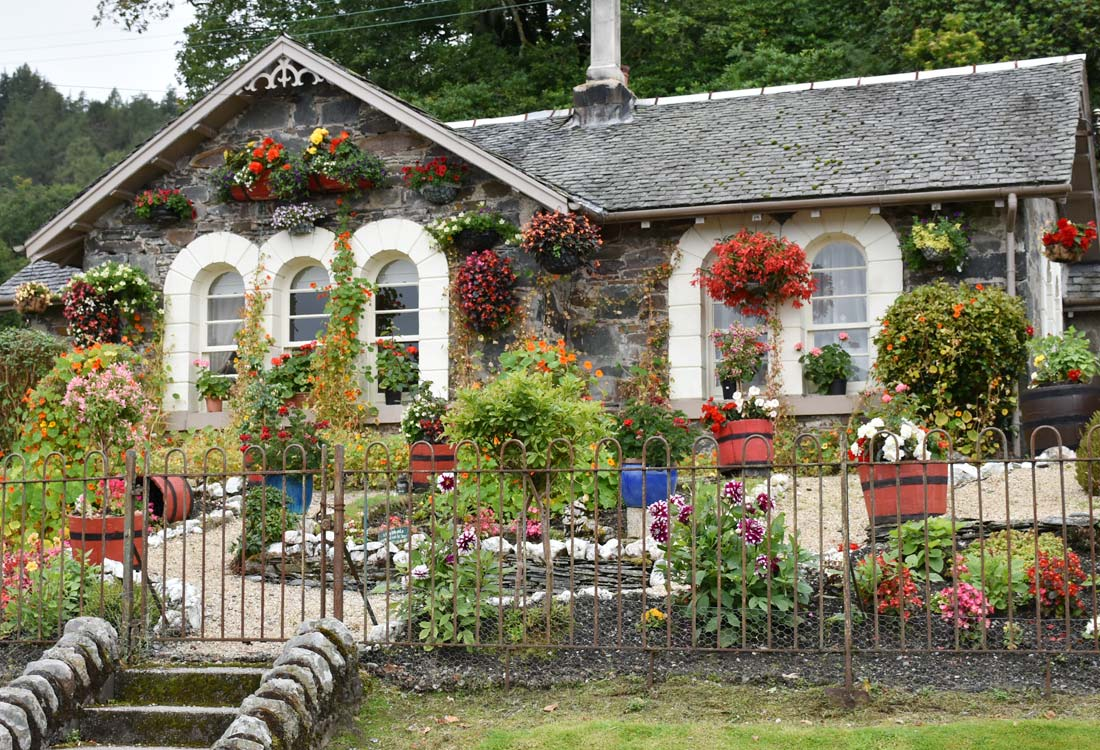 Flowers adorn the stone houses of Luss.