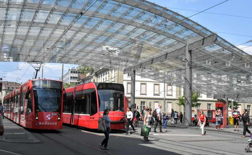 Trams stop beside the train station in Bern, Switzerland