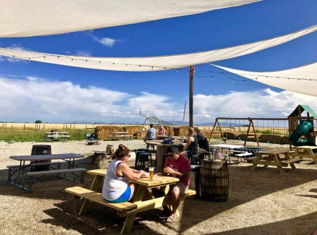 Farm fields surround the outdoor beer patio.